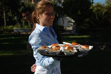 Waitress serving bowl foods at a recent cocktail event with a barbecue in Toorak